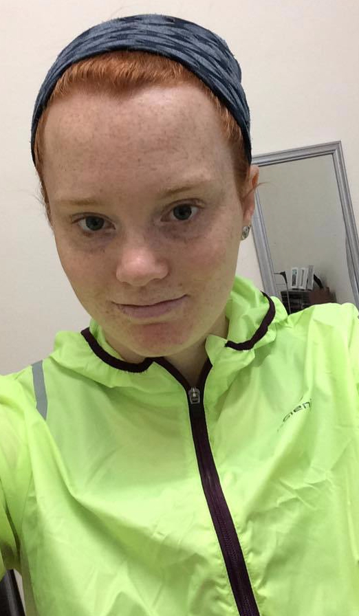 girl runner in reflective jacket